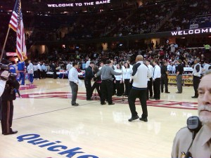 They walk you out to center court and start fussing over you.